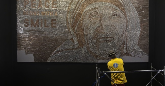 Albanian artist builds Mother Teresa's mosaic with staples