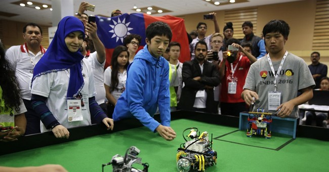 2 Taiwanese teenagers win World Robot Olympiad in India