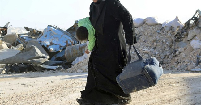 The Latest: Chemical weapons watchdog criticizes Syria