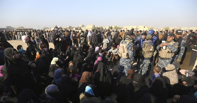 Residents of Iraq's Mosul fight, jostle over food