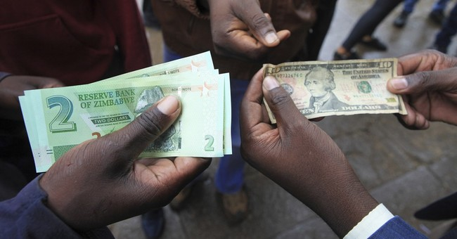 Zimbabwe issues new currency, bond notes