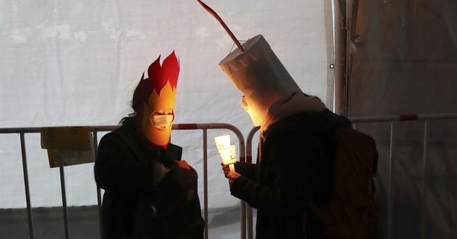 South Korean capital glows with anti-presidential fervor