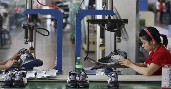 Official survey: China factory activity rises to 2-year high