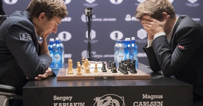 The Latest: Norwegian retains chess title