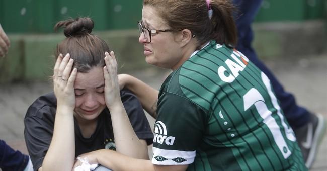 Thousands squeeze into church, stadium to mourn tragic crash