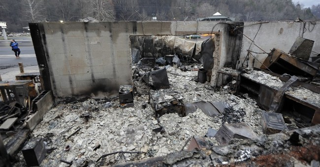 The Latest: Man charged with setting 65 acre Tennessee fire