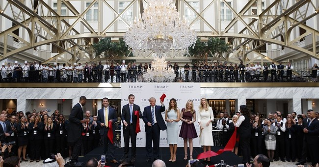 To move into White House, Trump may have to dump DC hotel