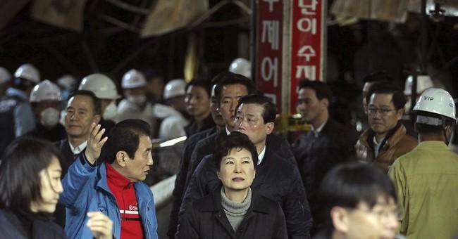 S. Korea's Park cries during public appearance amid scandal
