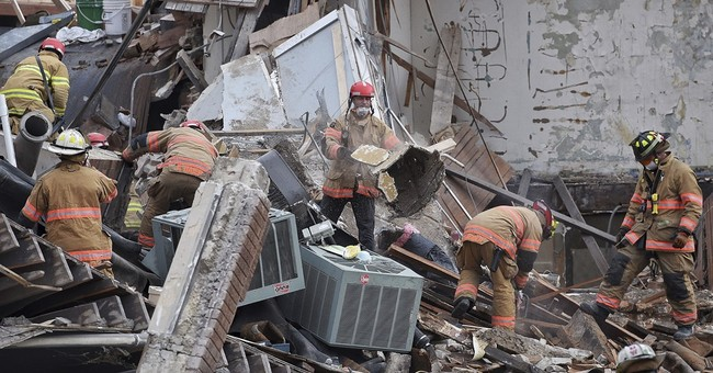 The Latest: Worker found dead in building collapse