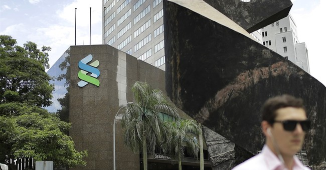 Singapore fines banks for 1MDB Fund links
