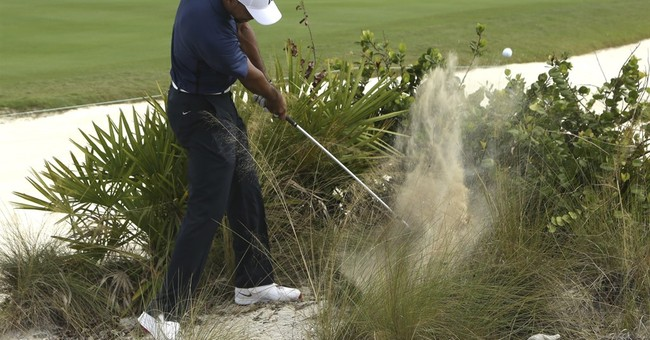 Tiger avoids mistakes and posts 65 in 2nd round back
