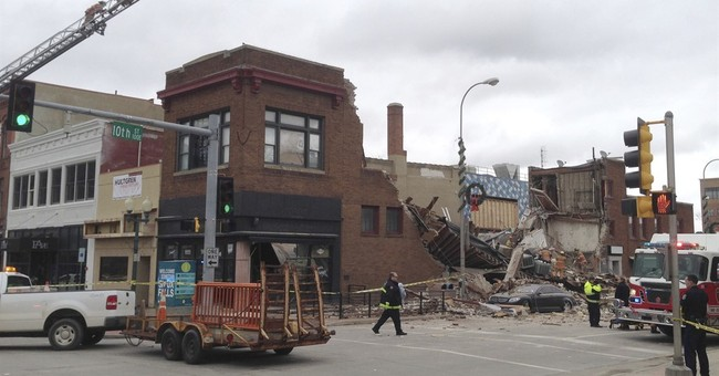 Woman talked on phone with rescuers after building collapsed