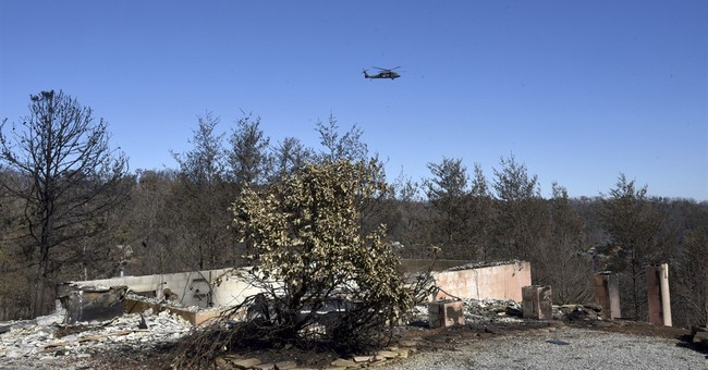 The Latest: In wildfires, son says parents 'died happy'
