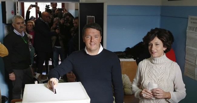 The Latest: Renzi resigns after losing reforms referendum