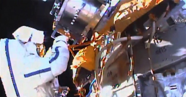 Spacewalkers collect experiment, toss flash drive overboard