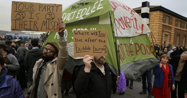 Dozens protest homeless removal from Super Bowl area