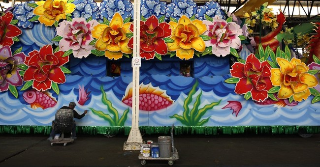 Glitter, feathers, paint: New Orleans preps for Mardi Gras