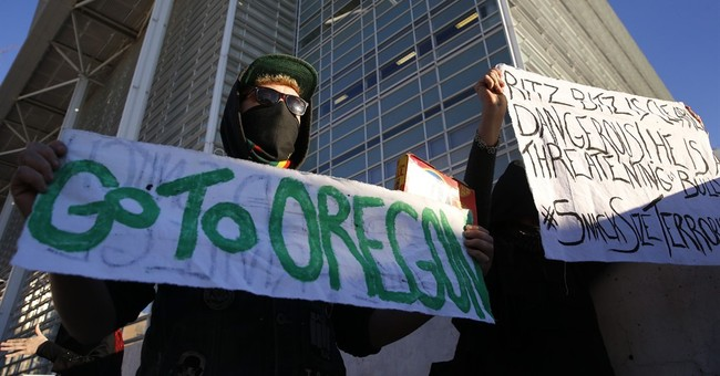 The Latest: Judge lets occupier attend rancher's funeral