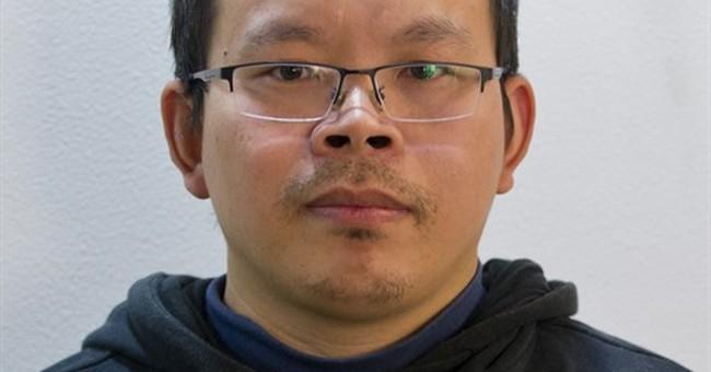 APNewsbreak: Missing reporter tells wife he's back in China