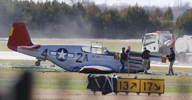 Vintage military plane makes belly landing at Dallas airport