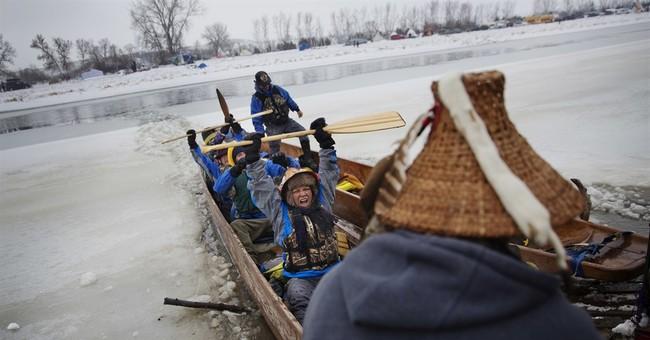 Winter menaces N. Dakota camp as pipeline protesters dig in