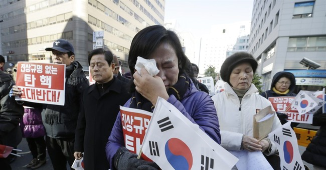 S Korea officials want woman at heart of scandal to testify