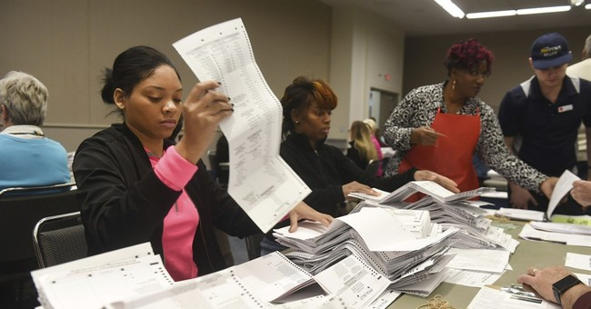 The Latest: Federal judge agrees to end Michigan recount
