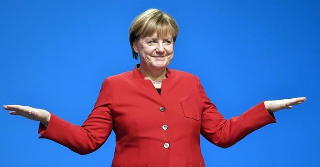 German conservatives back Merkel amid tough talk on migrants