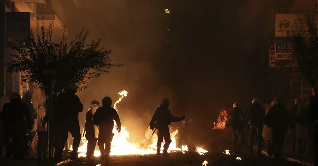 Riots rage in Athens after peaceful march over teen's death