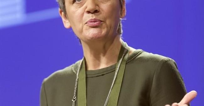 EU fines 3 banks $520 million over rate market rigging