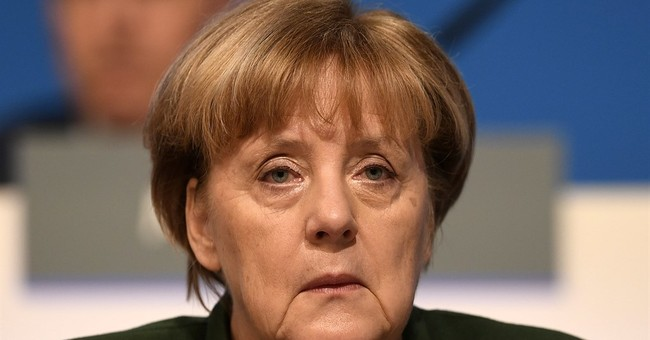 Merkel's conservatives back tougher rules on dual citizens