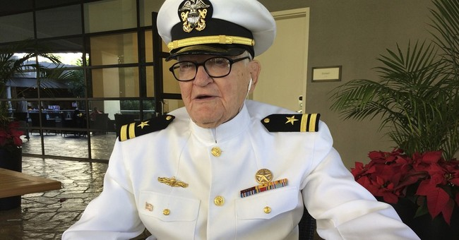The Latest: Wreaths presented to honor Pearl Harbor fallen