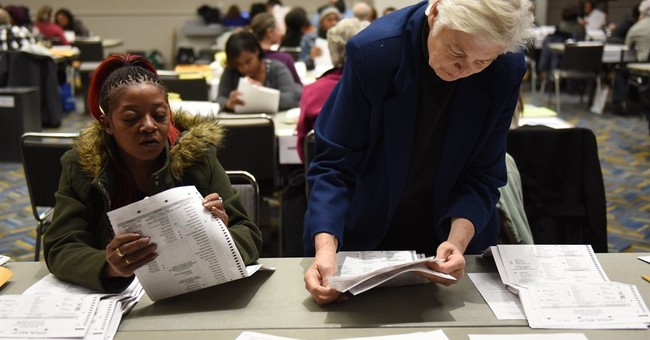 The Latest: Michigan wants recount halted if judge rules