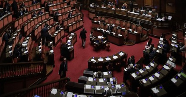 The Latest: Renzi asked to stay on as caretaker PM