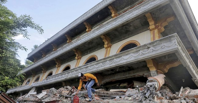 The Latest: Pope prays for victims of Indonesia quake