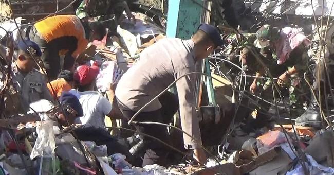 Aid groups descend on Indonesia quake zone; deaths reach 102