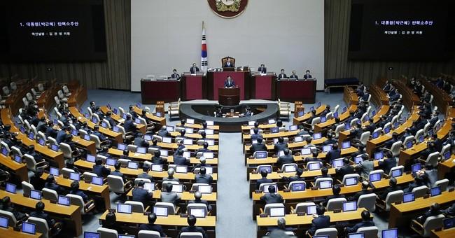 S. Korea's president loses power, keeps title, house, salary