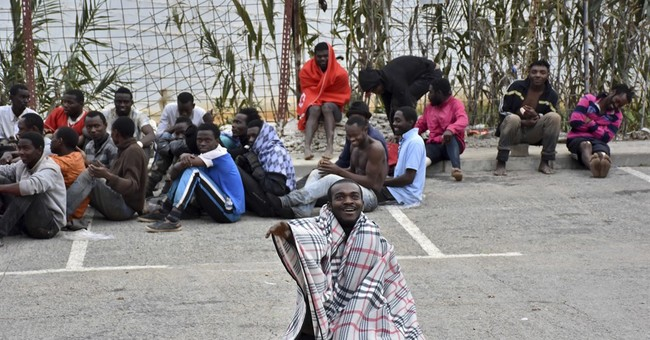 Spain: 400 migrants storm North African border fence