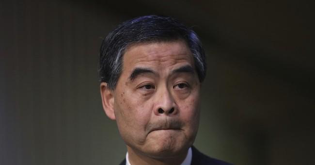Hong Kong leader Leung won't seek another term, cites family