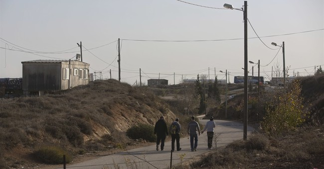 Facing evacuation, West Bank settlers remain defiant