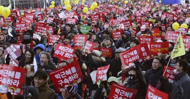 S. Koreans rally again, this time to celebrate impeachment