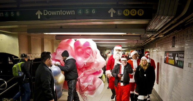 Red-suited SantaCon pub crawl revelers fan out across NYC