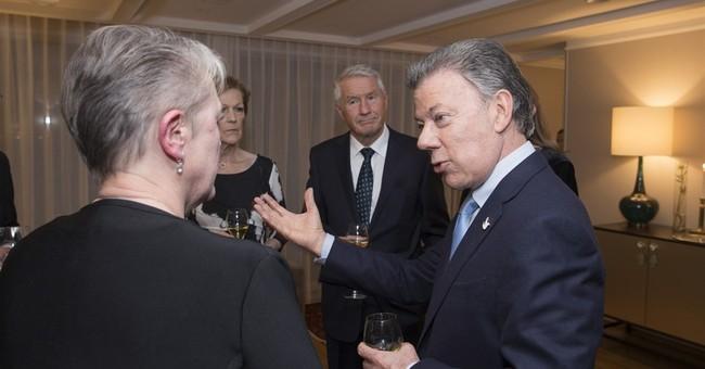 Colombia's Santos accepts Nobel, urges shift in drug war