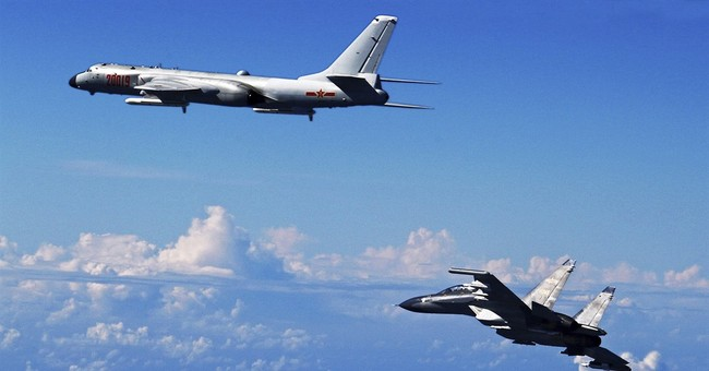 China conducts flyover of waterways near Japan, Taiwan