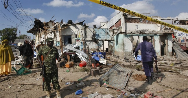 Car blast kills 16 at police station in Somalia's capital
