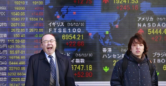 Asian stocks mixed ahead of Fed rates decision; oil soars