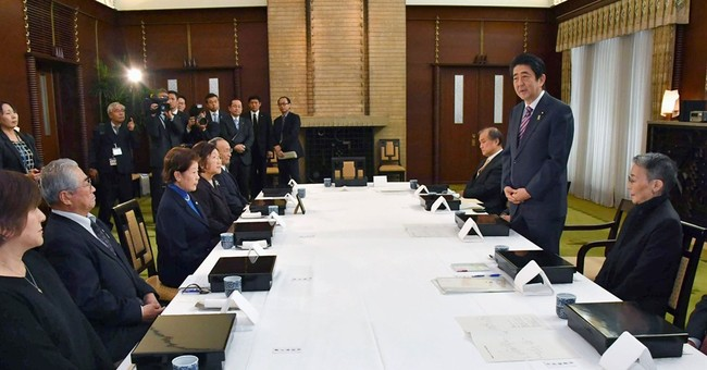Putin tries dog diplomacy before Japan talks over islands