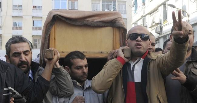 Hundreds bury Algerian journalist who died on hunger strike