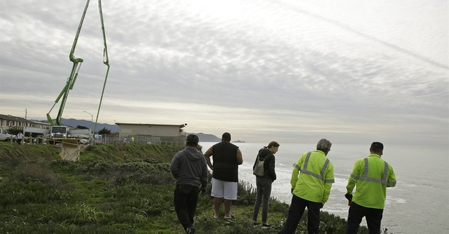 Concrete pumped into sinkhole on eroded California cliff