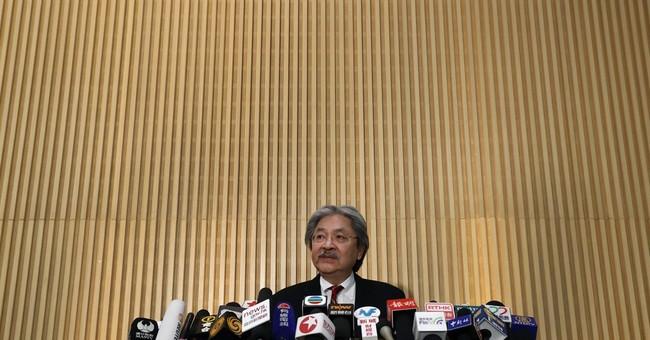 Hong Kong finance chief quits; leadership bid expected
